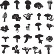 Black and white silhouettes of mushrooms — Stock Vector