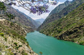 A valley river between mountains — Stock Photo