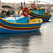 Colored boats, Malta — Stock Photo #13359233