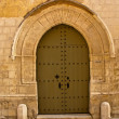 Ancient door in a house in malta island — Stock Photo #13441045