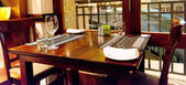 Table with empty glasses set in restaurant — Stok fotoğraf