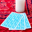 Tarot cards and burning candle — Stock Photo