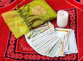 Tarot cards and burning candle — Stock Photo