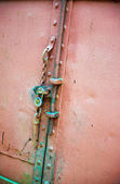 Weathered old door with lock and chain — Stock Photo