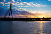 Sunset bridge river Daugava Riga — Stock Photo