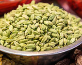 Green Cardamom seeds in a bowl — Stock Photo