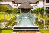 Peacful hotel fragment with glass bridge — Stock Photo