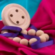 Ribbon, beads and wooden buttons on the fabric — Stock Photo