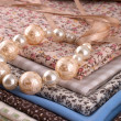Beads on fabric — Stock Photo