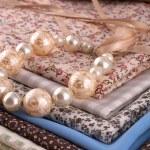 Beads on fabric — Stock Photo