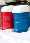Iron barrels in the snow — Stock Photo