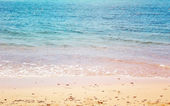 Sea on sunny sand beach — Stock Photo