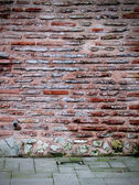 Rogu ściany cegła — Zdjęcie stockowe