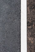 Asphalt and soil — Stock Photo