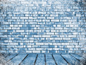 Brick wall and floor in snow — Stock Photo