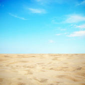 Azure sky with sandy beach — Stock Photo