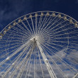 Ferris wheel on a blue sky as a background, Marseille France - Stock Photo