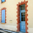 Door and windows with blue shutters in a village, Burgundy, Fran - Stock Photo