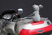 Motorbike with toy on the trunk. Fragment — Stock Photo