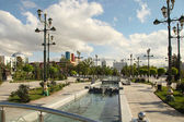 Fountain and lampposts in the park. Ashkhabad. Turkmenistan. — Stock Photo