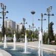 Fountain, lampposts and some living building. Ashkhabad. Turkmen — Stock Photo