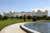 Palace with columns, domes and foutain in front. Ashkhabad. Turk — Stock Photo