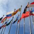 Stock Photo: Different countries flags united together against blue sky