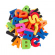 Colorful symbols heap of alphabet. Education concept. Isolated o — Stock Photo #35536439