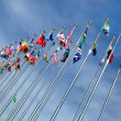 Different countries flags united together against blue sky — Stock Photo #36001731