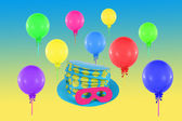 Colorful balloons and hat with mask for party and carnival — Stock Photo