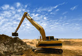 Orange excavator at Construction irrigation canal in Desert — Foto Stock