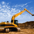 Stock Photo: Orange excavator at Construction irrigation canal in Desert