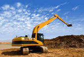 Orange excavator at Construction irrigation canal in Desert — Stock Photo