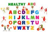 Alphabet written in multicolored plastic kids letters — Stock Photo