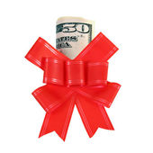 Dollars under a red bow on white  — Stock Photo