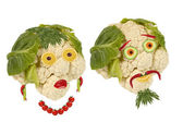 Creative food. Portrait two old man made ??of vegetables and fru — Stock Photo
