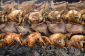 Quail strung on a skewer and grilled in barbecue — Stock Photo
