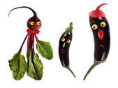 Funny portraits made ??of beet and eggplants  — Stock Photo