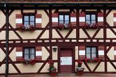 Two rows of windows with flower decoration in  Nuremberg — Stock Photo