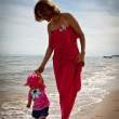 Mother with her baby  having fun on the beach — Stock fotografie