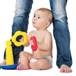 Baby play on white background with mother — Stock Photo