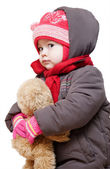 Baby in winter clothes on a white background — Stock Photo