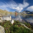 Tevno Lake in Pirin Mountain, Bulgaria, beautiful sky and hut — Stock Photo