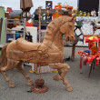 Flea market. Old wooden horse and retro derby trophies — Stock Photo
