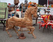 Flea market. Old wooden horse and retro derby trophies — Stockfoto