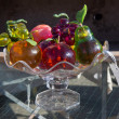 Vase with glass fruits at flea market — Stock Photo