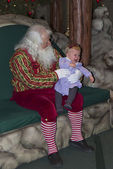 Santa Claus with crying toddler girl. — Stock Photo