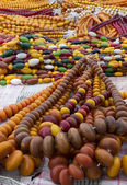 Colorful strung beads at flea market — Stock Photo