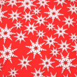 Abstract white snowflake on a red background — Stock Photo