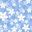 Vector seamless pattern with white and blue flowers on a blue background. — Stock Vector